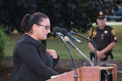 "JoAnn Steil, widow of fallen Detroit Police Officer Kenneth Steil,  shares the poem ""I am an officer's wife"" during the ceremony. (Aileen Wingblad/Digital First Media)"