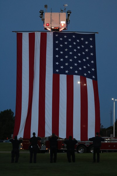 Waterford Regional firefighters take down the flag at the ceremony's conclusion. (Aileen Wingblad/Digital First Media)