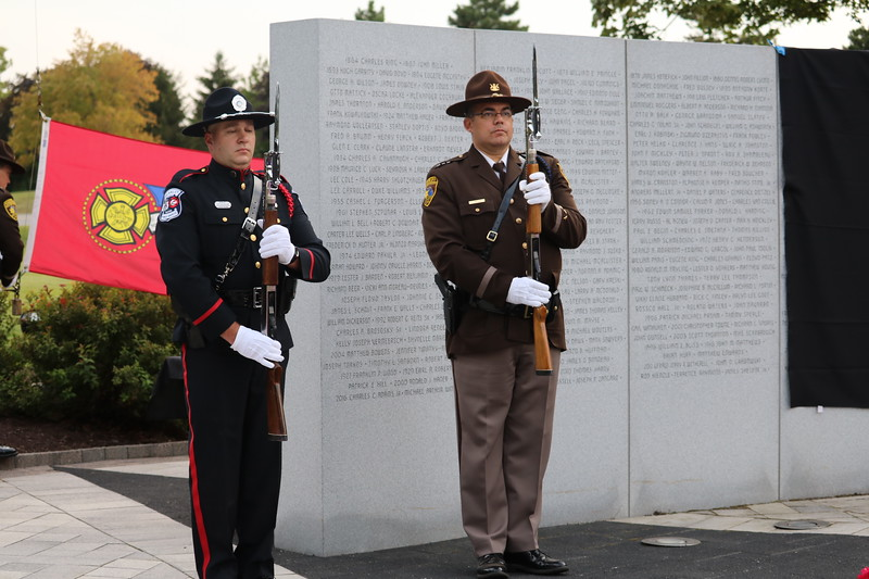 Officers at the memorial's Lost Heroes Wall.  (Aileen Wingblad/Digital First Media)