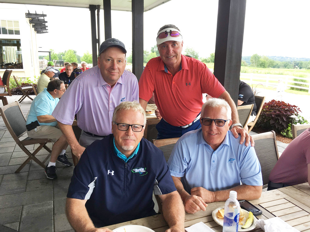 . Seated, from left, Dan Durkin of Tyngsboro and Mark Meehan of Lowell; standing, Bob Ryan of Lowell and Geno Kelly of Salem