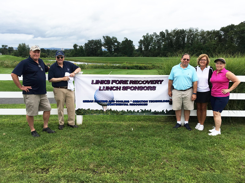 Representing The Lowell House, from left, Tom Treacy of Lowell, CEO Bill Garr of Walpole, Jon Kurland of Chelmsford, Kelly Ryan of Lowell and Carol O'Brien of Tewksbury