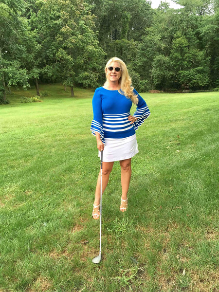 Who knew golf could be so effortless?: Sometimes I will wear a golf matching-set skirt and top. But this time, I opt for a white Tehama Nancy Haley golf skirt. I added my own flair with a knit royal blue and white-striped, light-weight sweater with bell sleeves. Having fun with this look, I add a pair of white BCBGirls wedges. After all, a girl doesn't have to golf to look good!