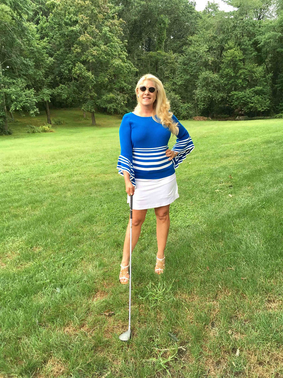 . Who knew golf could be so effortless?: Sometimes I will wear a golf matching-set skirt and top. But this time, I opt for a white Tehama Nancy Haley golf skirt. I added my own flair with a knit royal blue and white-striped, light-weight sweater with bell sleeves. Having fun with this look, I add a pair of white BCBGirls wedges. After all, a girl doesn�t have to golf to look good!