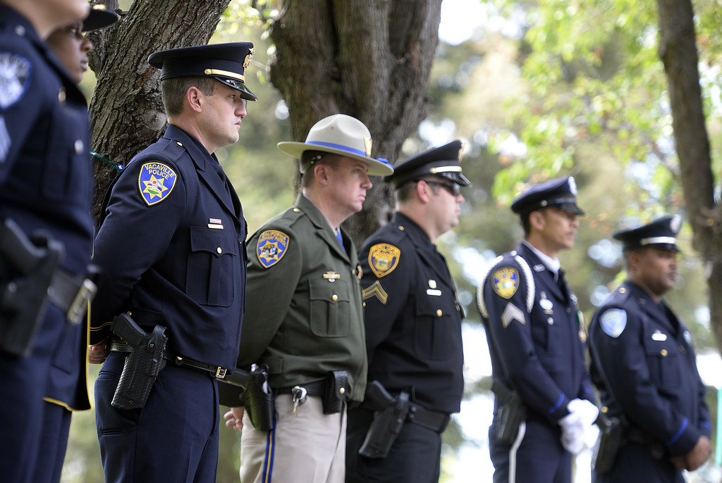 . Vacaville Police Officer, Kenny Meek (left) stands with fellow Solano County law enforcement officers atop the memorial wall during the 2018 Solano County Peace Officer\'s Memorial Wednesday in Fairfield. Joel Rosenbaum -- The Reporter
