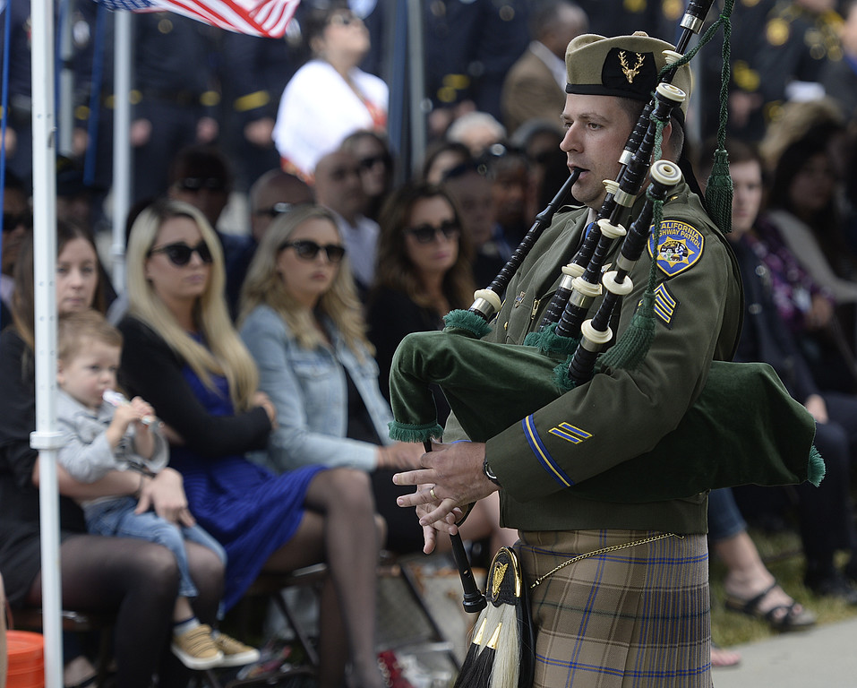 ". A member of the California Highway Patrol\'s honor guard plays ""Amazing Grace\"" on the bagpipes at the conclusion of the 2018 Peace Officer\'s Memorial Wednesday in Fairfield. Joel Rosenbaum -- The Reporter"