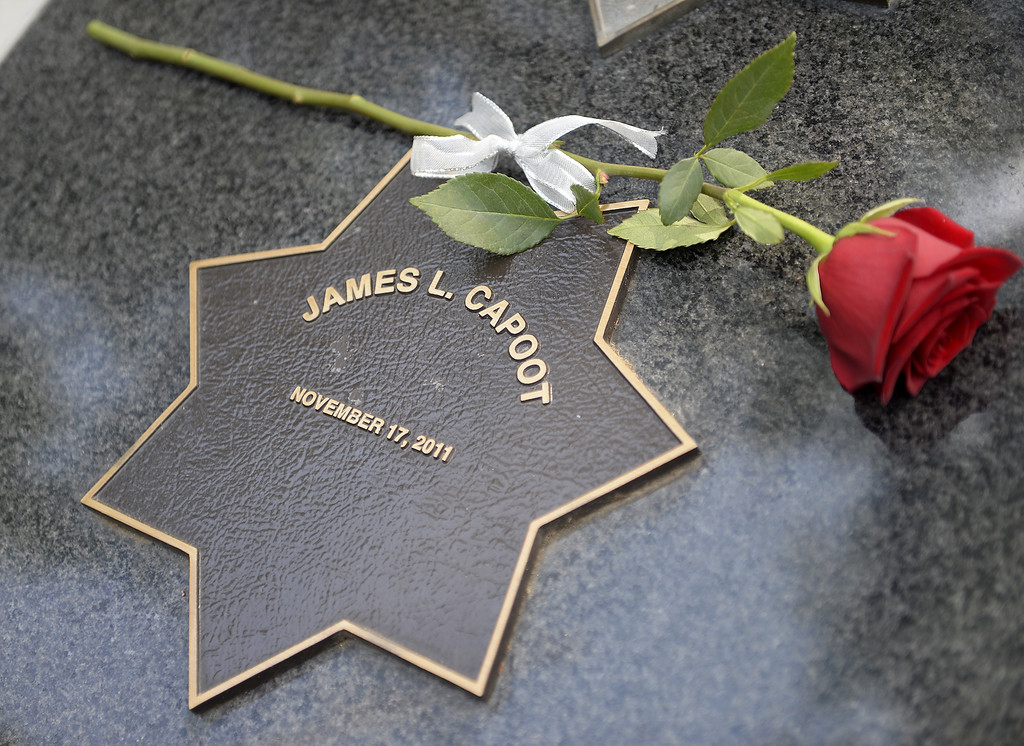 . A single red rose was placed upon the memorial star of Vallejo Police officer, James L. Capoot by his daughter, Justine at the conclusion of the 2018 Peace Officer\'s Memorial Wednesday in Fairfield. Joel Rosenbaum -- The Reporter