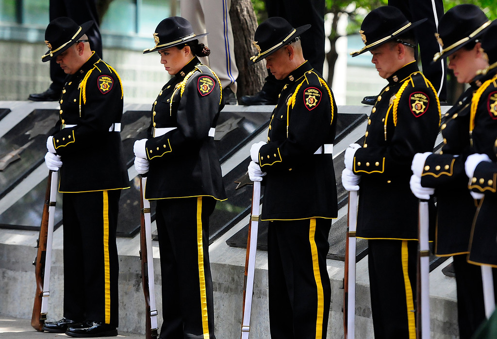 . FAIRFIELD, CA - MAY 16, Solano County Sheriff deputies bow their heads in prayer during the 2018 Peace Officers\' Memorial Service on Wednesday in Fairfield. (Chris Riley/Times-Herald)