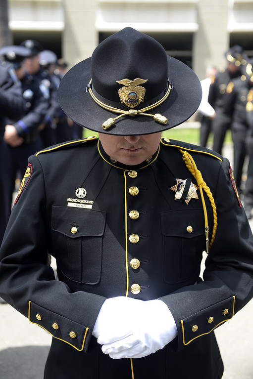 . A Solano County Sheriff\'s deputy bows his head as the closing prayer is delivered during the 2018 Peace Officer\'s Memorial Wednesday in Fairfield. Joel Rosenbaum -- The Reporter