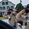 KRISTOPHER RADDER — BRATTLEBORO REFORMER<br /> Sgt. First Class Robert Lakin, Sgt. Dana Shepard, and Deputy First Class Tim Vinton, of the Windham County Sheriff's Office salute the American flag flying over Vernon Town Hall, in Vernon, Vt., during a moment of silence held for Vermont's fallen law enforcement officers across the state on Friday, May 15, 2020.
