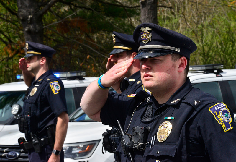 KRISTOPHER RADDER — BRATTLEBORO REFORMER<br /> Members of the Brattleboro Police Department, in Brattleboro, Vt., line up in formation to salute the American flag during a moment of silence held for Vermont's fallen law enforcement officers across the state on Friday, May 15, 2020.