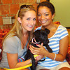 Casey's friends, Brooke Burdge and Kelsey Butler at Animal Haven with the puppy named Casey.