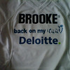 The front of  Brooke's shirt.