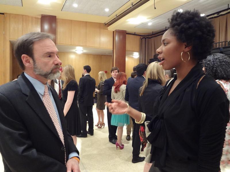 Joel Feldman speaks to Monique John at the dinner. Monique John was recognized  for her receipt of a Casey Feldman Foundation internship scholarship.