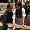 Students at University High School reaching for EndDD wristbands after the presentation.
