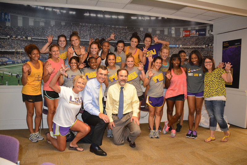 Joel Feldman and Burton LeBlanc photographed with the LSU Women's Gymnastic team.