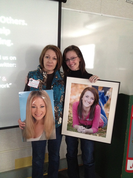 Dianne Anderson (L) and Liz Catherman, mothers of Casey Feldman (L) and Kassy Kerfoot, showing pictures of their daughters lost to distracted driving to the Idaho students.