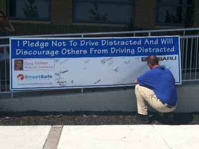 Guests were able to sign a banner pledging to refrain from distracted driving