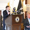 Joel Feldman speaking at the press conference as Governor Chafee looks on