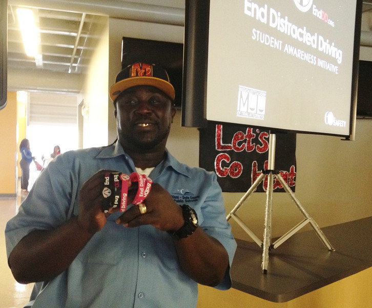 """Head Custodian at MAST Homestead H.S. in FLA, Mr. Wilkerson, displaying the EndDD.org wristbands. """"I want to take one home for my daughter."""""""