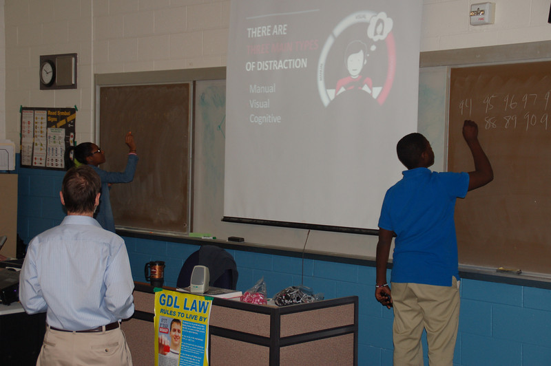Students participating in an exercise demonstrating cognitive distraction.