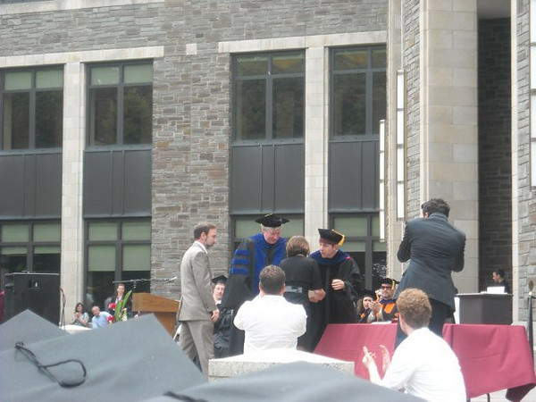 Casey's parents, Joel Feldman and Dianne Anderson accepting Casey's diploma.