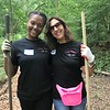 India Henderson and Marcy Monheit take a break for a photo while performing trail work! Day of Service 2018