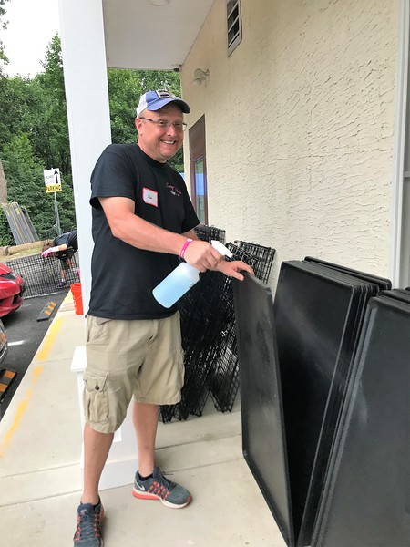 Rob King - cleaning the dog crates. Day of Service 2018