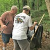 Jack McGowan and Dave Robbins spreading chips on the dog trail. Day of Service 2018