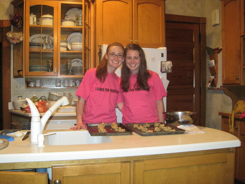 Casey's cousins, Julia and Tess Feldman, ready to pop the chocolate ship cookie in the oven.