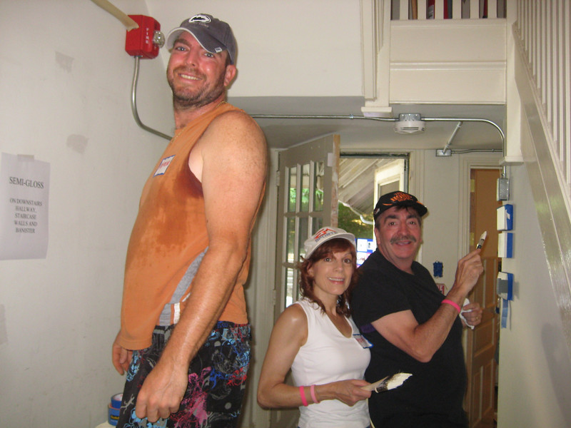 The Corey family, Damon (front), Mary and Bud painting the downstairs hallway.