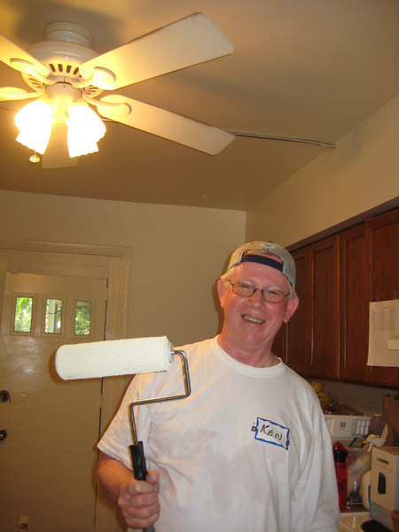 Ken Garrity painting the kitchen.