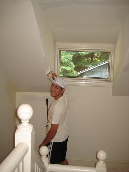 Phil Knasiak painting the stairway.