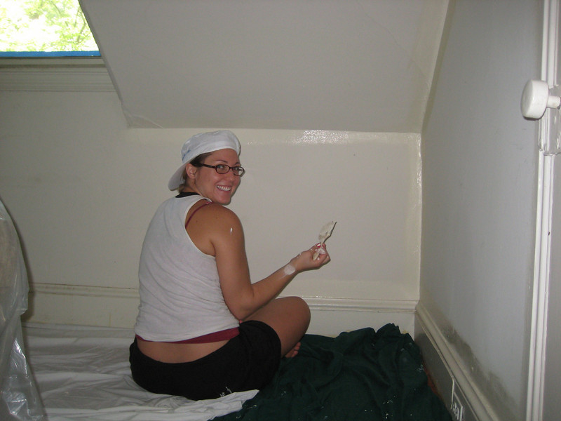 Kasey Borbidge painting painting Heather's (the kennel director) office on the 2nd floor.