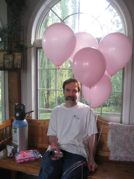 Casey's father, Joel blowing up the balloons!