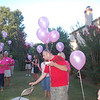 .Gathering to release the balloons.