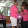 Aunt Janice and Uncle Jim Gallagher blowing up the balloons as Rachael Ceffaratti looks on.