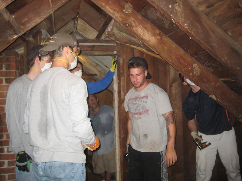 Insulating the attic! Matt Thornton, Matt Grace, Ryan Gellar and Jim Donahue.