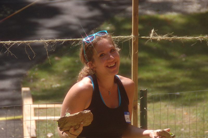 Victoria Mayo helping out with the removal of rocks in the upcoming doggie play area.