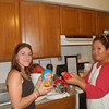 Francisvale volunteers filling the chew toys with peanut butter.