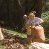Nancy Chester and Betty Thornton raking and bagging leaves.