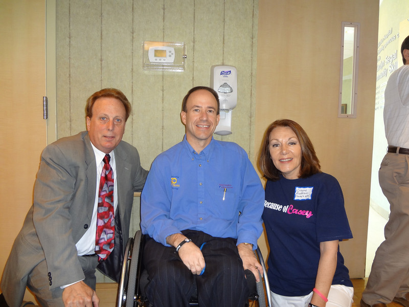 Jack Carroll, President and CEO of Magee Rehabilitation Hospital (L), Mark Chilutti, Assistant VP of Development Magee Rehab Hospital Foundation and Casey's mother, Dianne L. Anderson