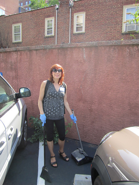 Mary Corey helps clean the parking lot.