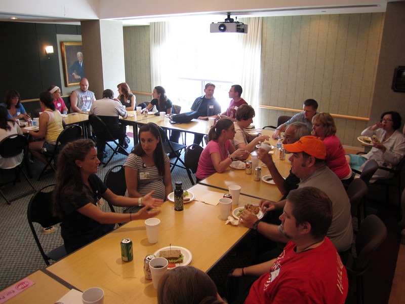 Volunteers gather for lunch after a morning of service.