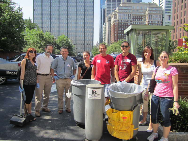 Volunteers pause from their cleanup for a photo-Mary Corey (L), Joel Feldman, Mike Monheit, Margaret Ciavarelli, Scott Thornton, Phil Knasiak, Melissa Hague and Jackie Fedeli