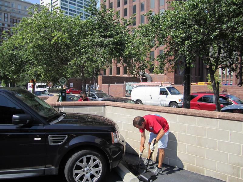 Scott Thornton helps clean the parking lot