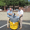 Mike Monheit (L) and Casey's father, Joel Feldman clean up the parking lot at Magee