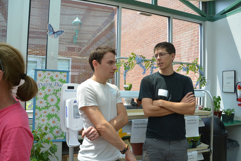 Chris (R) and Casey's cousin, Nick Seminoff in the greenhouse at Magee