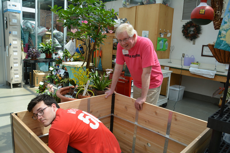 Riley Vroome and Ken Garrity putting together raised beds