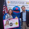 Casey Feldman's parents, Dianne Anderson and Joel Feldman pose with Grover, the Sesame Workshop symbol of  traffic safety