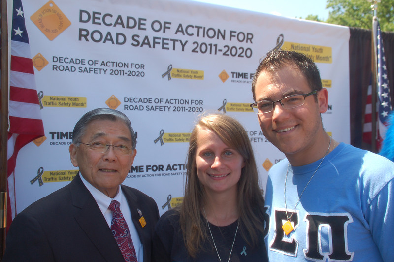 Phi Sigma Pi brothers Phil Knasiak and Jessica Barr  with the Honorable Norman Y. Mineta at the morning press event launching the Decade of Action For Road Safety 2011-2020